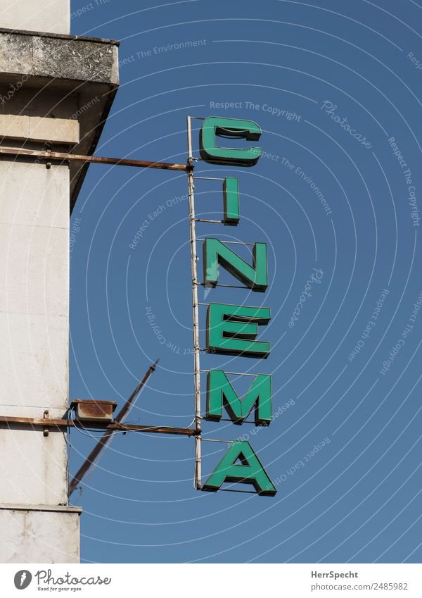 Old Green Building Facade Retro Characters Esthetic Signs and labeling Manmade structures Downtown Neon sign Cinema