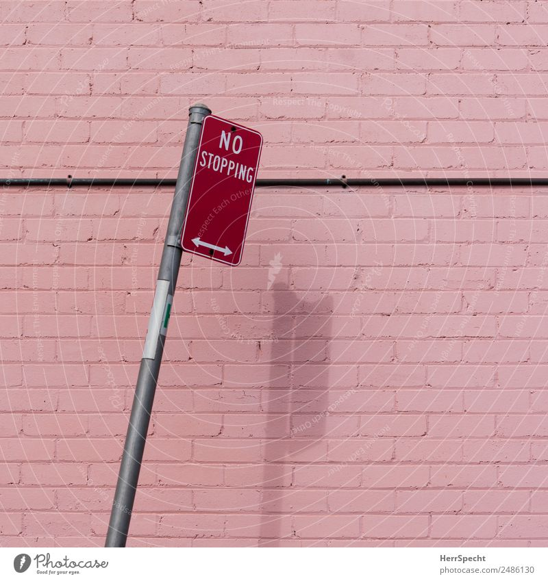 No stopping Beautiful weather Wall (barrier) Wall (building) Road sign Esthetic Pink Red No standing Tilt Play of colours Shadow Arrow Brick wall Reduced
