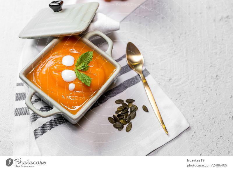 Cream of pumpkin in bowl. Food Vegetable Soup Stew Dinner Vegetarian diet Diet Plate Bowl Spoon Healthy Eating Autumn Sour Yellow Tradition Pumpkin cream
