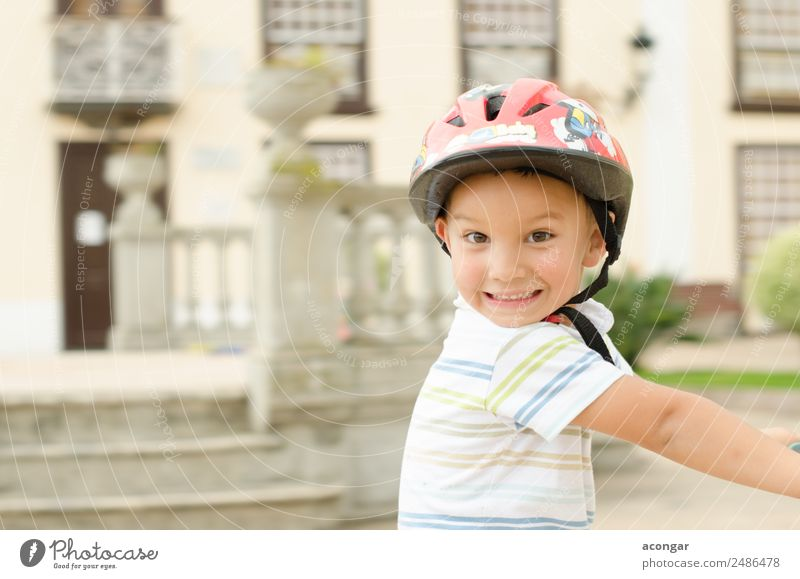 A funny boy riding his bicycle Joy Happy Beautiful Face Cycling Child Human being Masculine Boy (child) Infancy 1 3 - 8 years To enjoy Happiness Fresh Funny