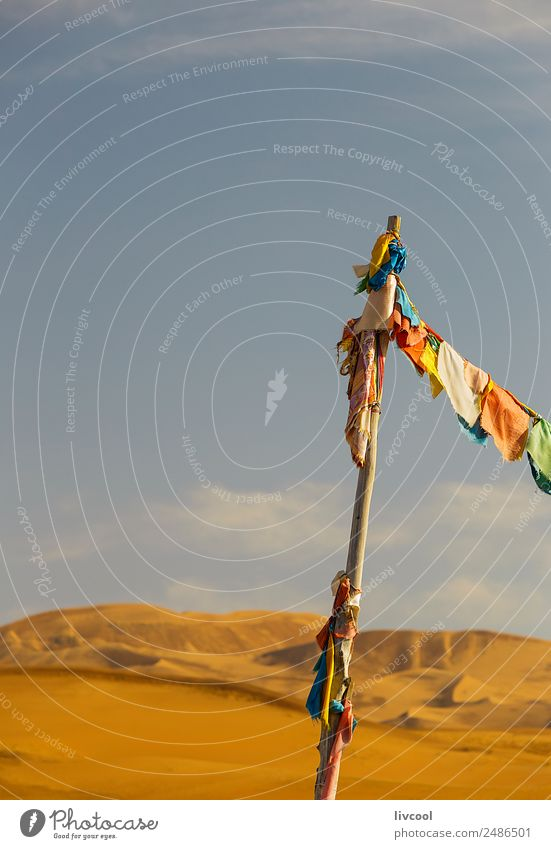 buddhist banners on lake badain miao, china Culture Landscape Sky Clouds Autumn Wind Hill Lake Desert Places Building Decoration Sand Flag Infinity Natural Dry