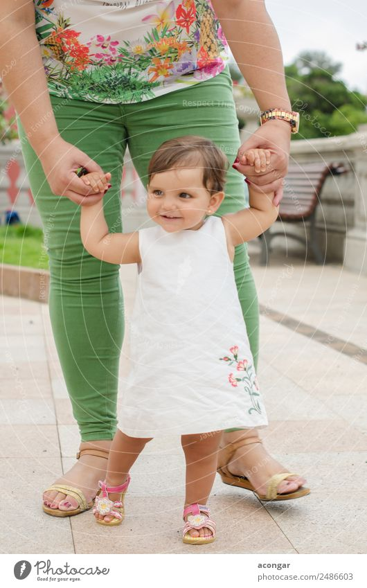 One year old girl learning to walk Happy Beautiful Face Child Human being Feminine Baby Girl Infancy Hand 1 0 - 12 months 1 - 3 years Toddler Dress Smiling