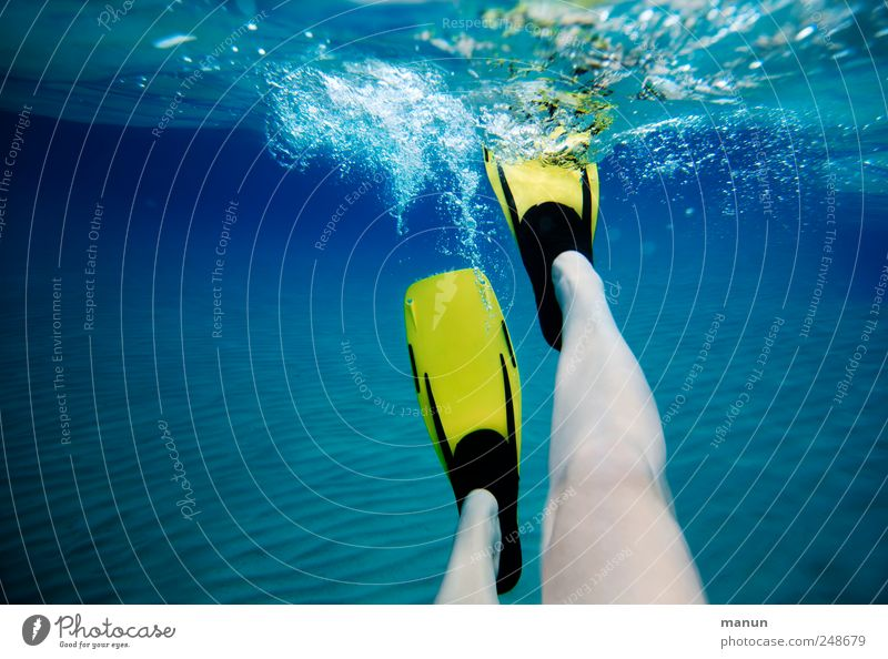 Human being Blue Water Vacation & Travel Ocean Joy Yellow Relaxation Life Movement Legs Leisure and hobbies Swimming & Bathing Natural Authentic Perspective