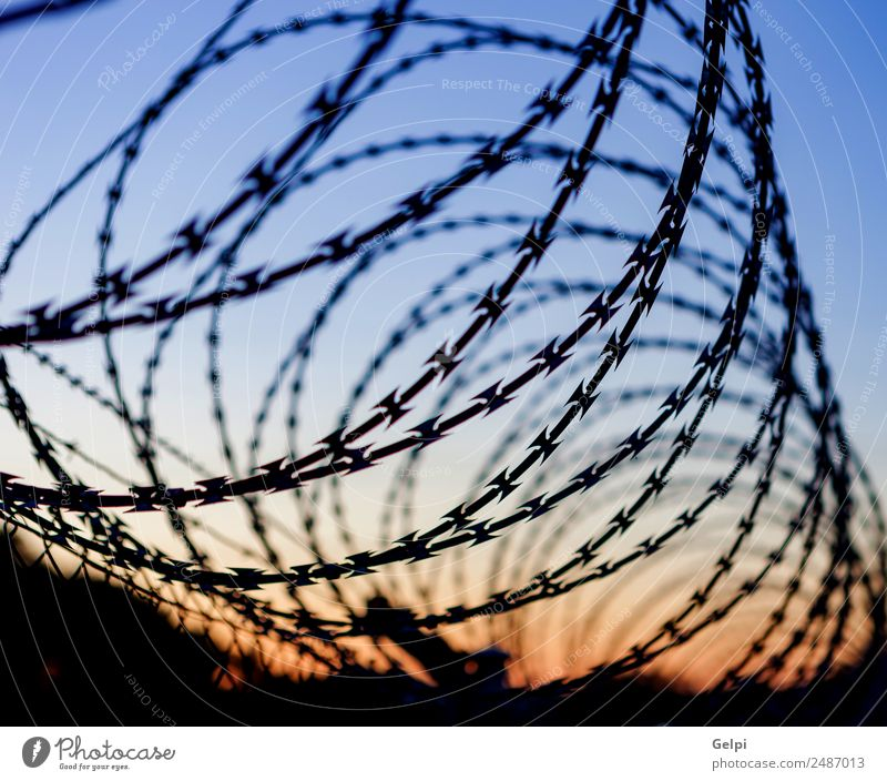 Fence with a barbed Freedom Camping Sky Metal Steel Rust Line Blue Black White Safety Protection Safety (feeling of) Dangerous War wire Penitentiary sharp