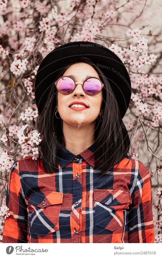 Brunette girl near a almond tree Style Happy Beautiful Face Garden Human being Woman Adults Nature Tree Flower Blossom Park Fashion Sunglasses Hat Smiling