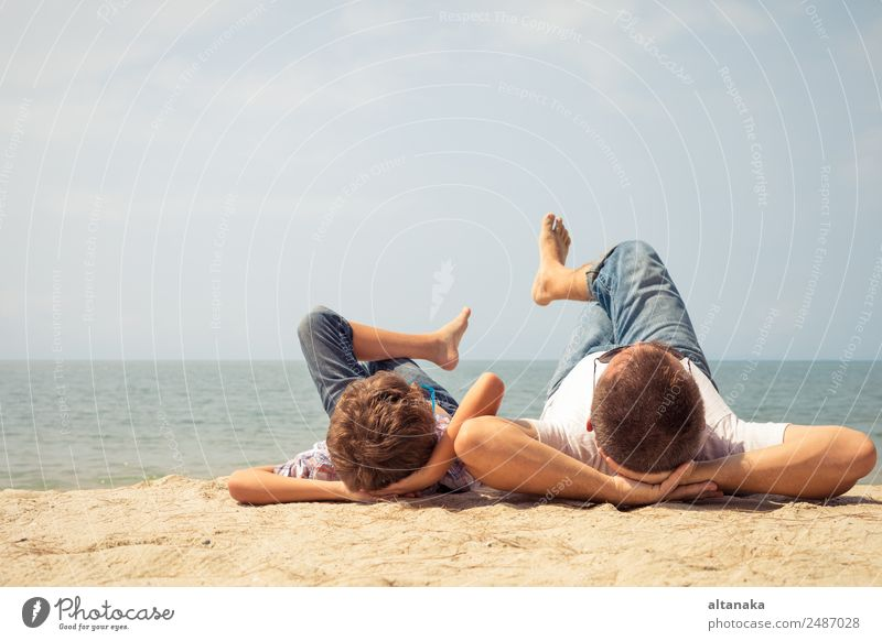 Father and son playing on the beach Child Human being Vacation & Travel Man Summer Relaxation Joy Beach Adults Lifestyle Sports Family & Relations Happy