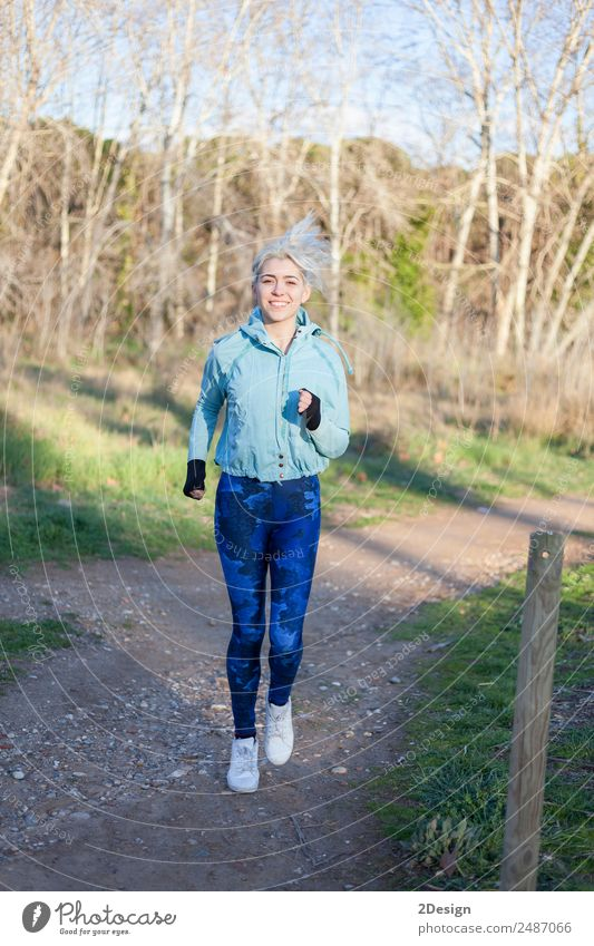Active and sporty woman runner in autumn nature Woman Human being Nature Youth (Young adults) Young woman Beautiful Relaxation Girl Winter Forest Adults