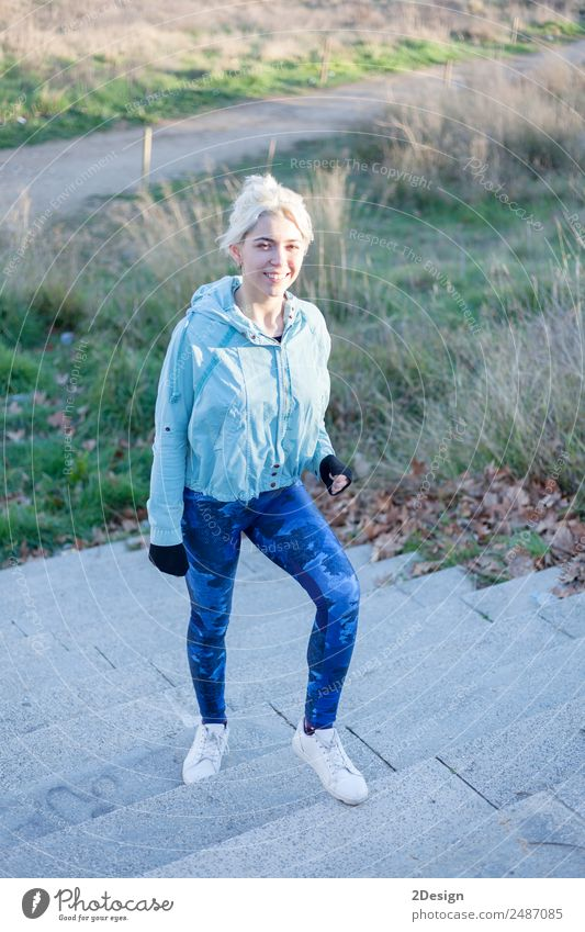 Portrait of a young woman walks outdoor as workout Lifestyle Happy Beautiful Leisure and hobbies Sports Track and Field Jogging Work and employment Human being