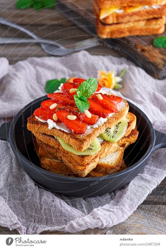 pile of French toast Fruit Bread Candy Breakfast Lunch Pan Table Eating Fresh Above Brown Black Tradition french stuffed Strawberry food sweet Meal Gourmet