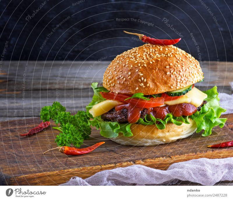 fresh homemade burger Meat Cheese Vegetable Bread Roll Lunch Fast food Table Restaurant Wood Eating Fresh Large Delicious Green Red Black Hamburger Cheeseburger