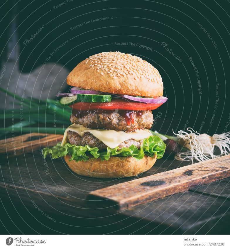 sandwich with two meat Meat Cheese Vegetable Bread Roll Lunch Fast food Table Wood Eating Fresh Large Delicious Green Red Black burger Hamburger Beef BBQ fast