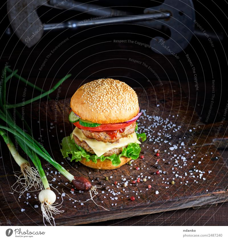 sandwich with two meat cutlets Meat Cheese Vegetable Bread Roll Lunch Fast food Table Wood Eating Fresh Large Delicious Green Red Black burger Hamburger Beef