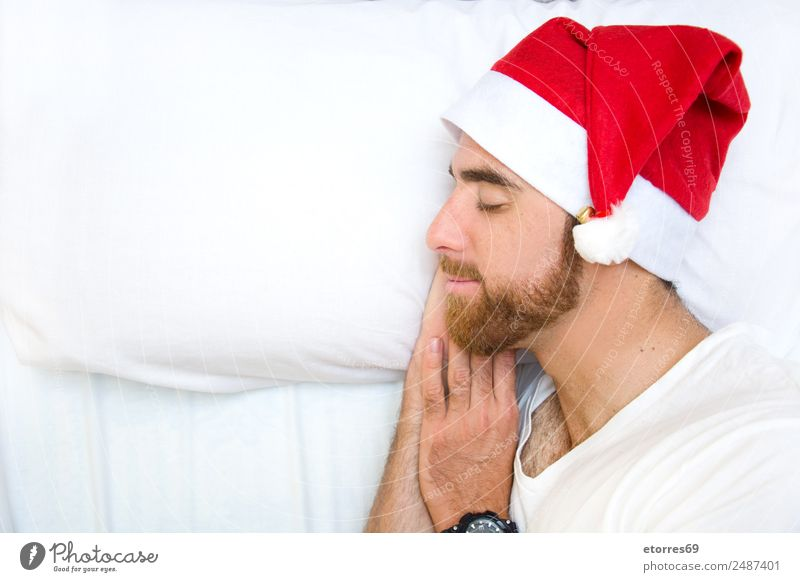Young man with Santa hat Human being Youth (Young adults) Man Christmas & Advent White Hand Red Relaxation Calm Face Adults Party Feasts & Celebrations