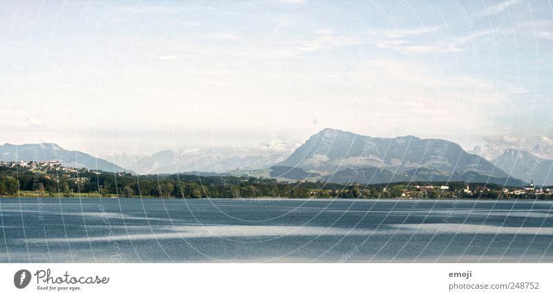 Sky Nature Blue Far-off places Mountain Lake Natural Switzerland Lakeside