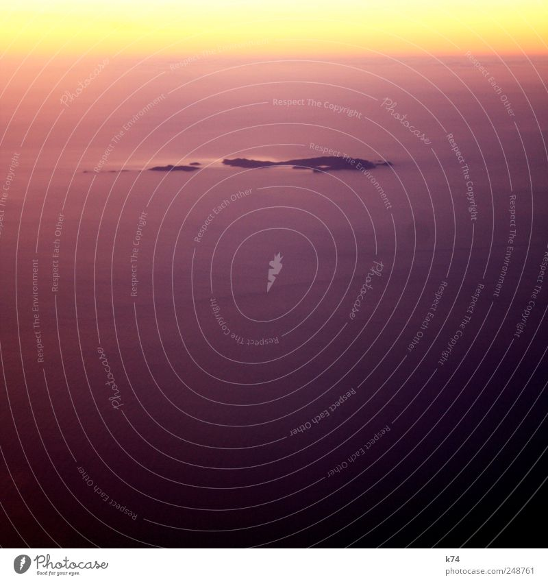 no man is an island Air Water Horizon Sunrise Sunset Sunlight Ocean Island View from the airplane Flying Soft Yellow Violet Emotions Moody Happiness Sadness