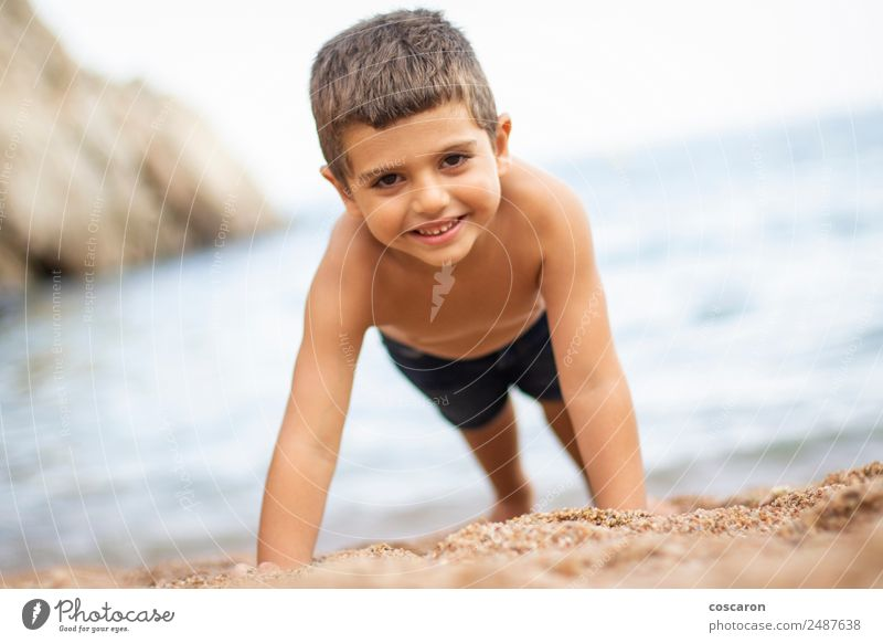 Little boy doing exercise at beach Beautiful Body Leisure and hobbies Playing Children's game Vacation & Travel Tourism Summer Summer vacation Sports