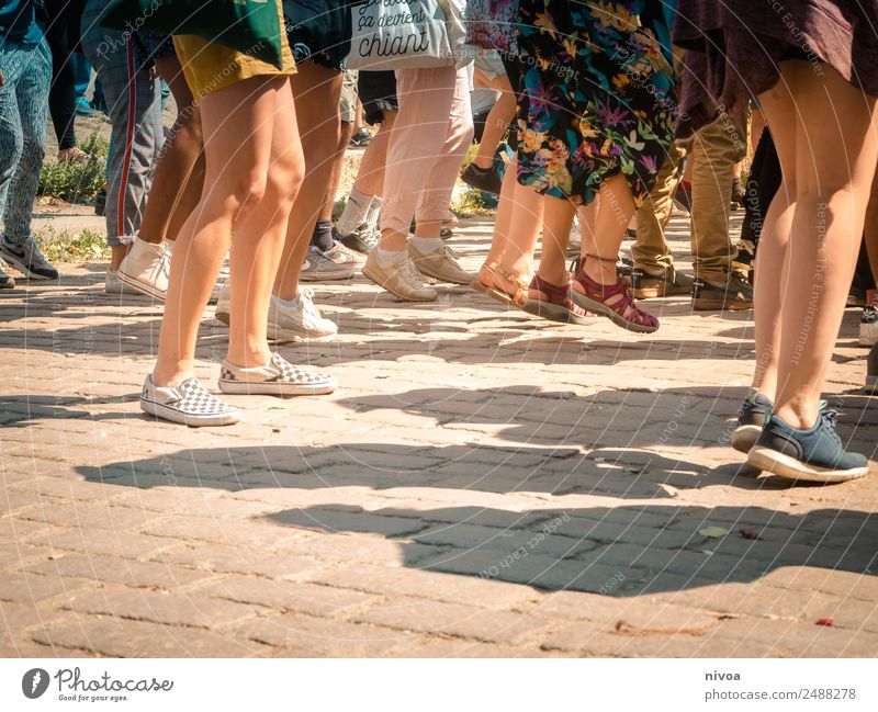 Many feet dancing, standing and jumping in one place Joy Happy Well-being Dance Jump Event Music Clubbing wall park Human being Masculine Feminine Woman Adults