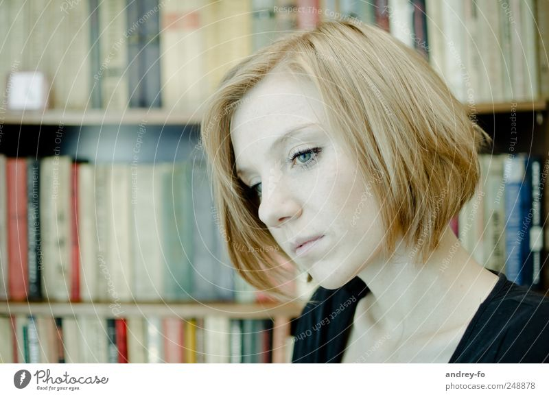 thoughtful. Feminine Young woman Youth (Young adults) Face 1 Human being 18 - 30 years Adults Library Hair and hairstyles Red-haired Short-haired Think Study