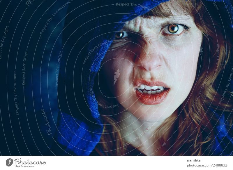 Angry young woman in darkness Human being Youth (Young adults) Young woman Blue Dark 18 - 30 years Face Adults Feminine Style Moody Fear Crazy Observe Anger