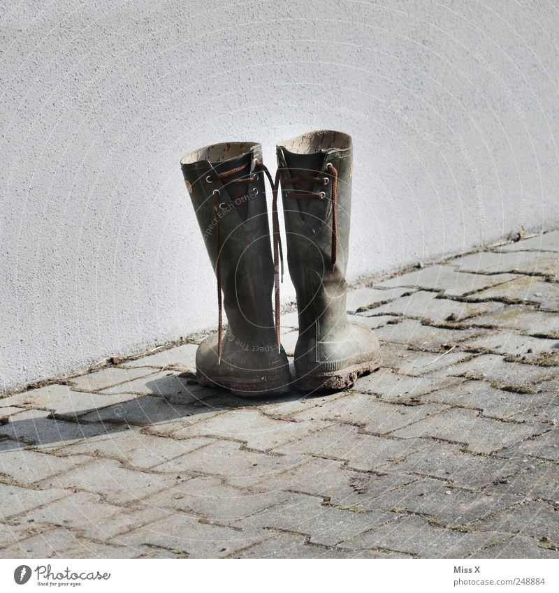 Old Latsch Footwear Boots Rubber boots Dirty Sidewalk Extract Shoelace Second-hand Farm Colour photo Subdued colour Exterior shot Deserted Copy Space left