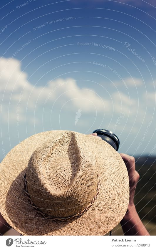 Human being Sky Blue Vacation & Travel Summer Far-off places Freedom Head Leisure and hobbies Masculine Trip Adventure Tourism Camera Hat Summer vacation