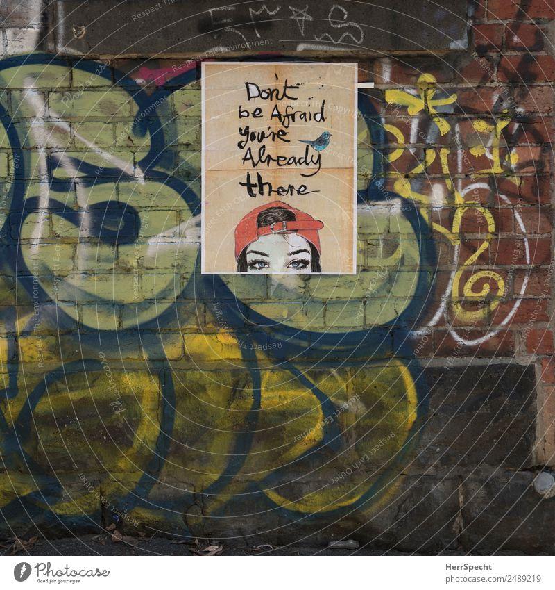 Town Graffiti Wall (building) Wall (barrier) Fear Characters Target Brave Trashy Street art Come Figure of speech Poster Brick wall Baseball cap