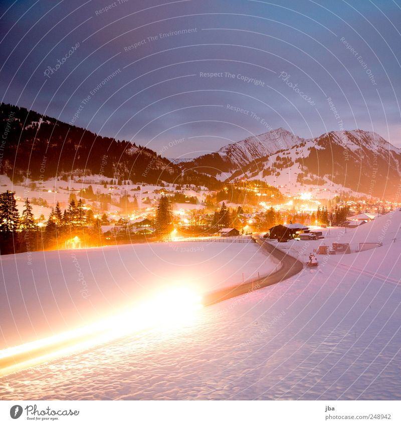 View to Gstaad Tourism Winter Snow Winter vacation Mountain Nature Clouds Alps Snowcapped peak Traffic infrastructure Passenger traffic Car headlights Movement