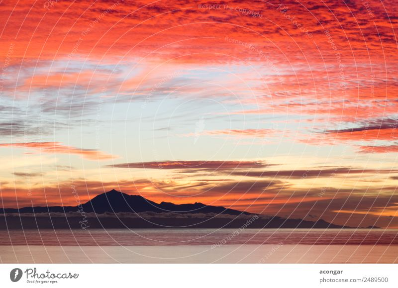 Sunrise in the sea for background. Ocean Nature Landscape Sky Clouds Horizon Coast Skyline Bright Gold Red Colour Canaries Spain Teide Tenerife calm Dramatic