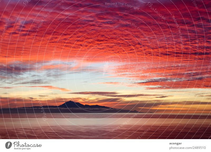 Sunrise in the sea for background. Ocean Nature Landscape Sky Clouds Horizon Coast Skyline Bright Multicoloured Gold Red Colour Canaries Spain Teide Tenerife