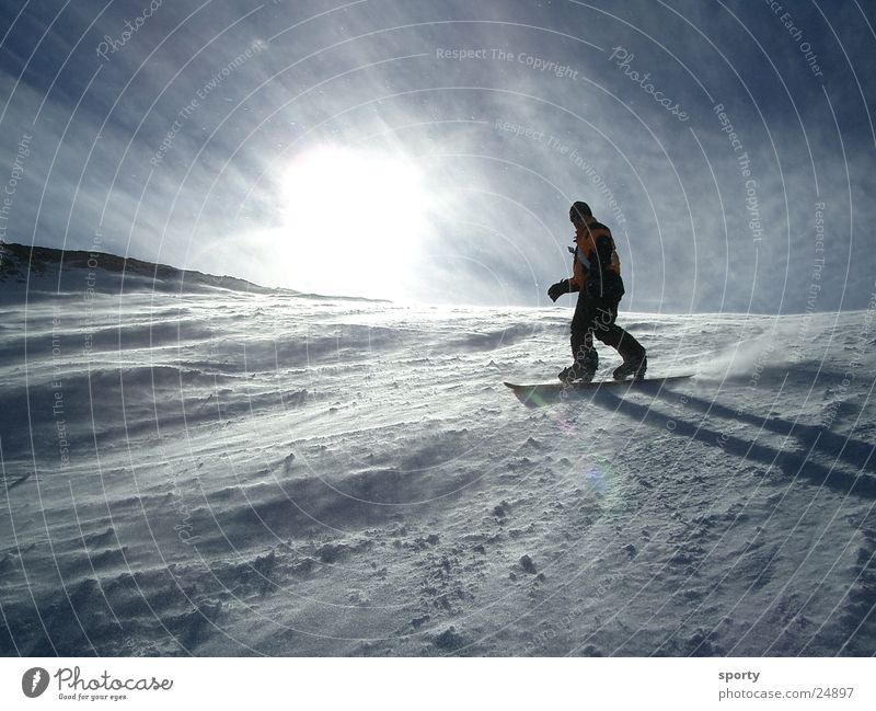 boarder Snowboard Vacation & Travel Sports Mountain Sun Joy Funsport Downward Winter sun Back-light Slope Swing Steep Wind Cold 1 Snowboarder Snowboarding