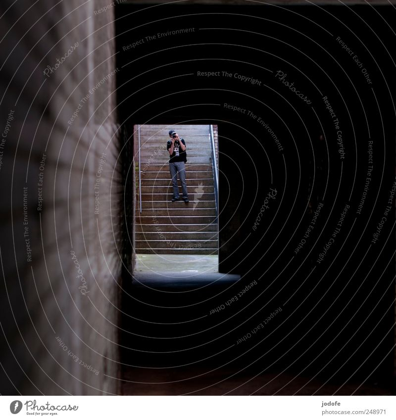 downstairs Human being Masculine 1 Stand Take a photo Stairs Corridor Tunnel Dark Wall (building) Observe Stop short Door Bright End Light Hope Go up Descent