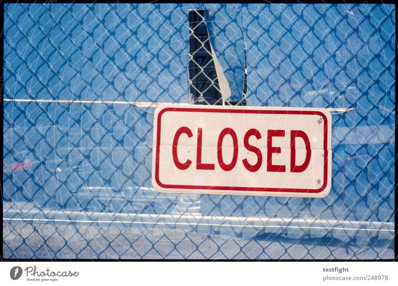 closed Metal Characters Signs and labeling Signage Warning sign Blue Red Fence Wire netting fence Colour photo Exterior shot Abstract Pattern