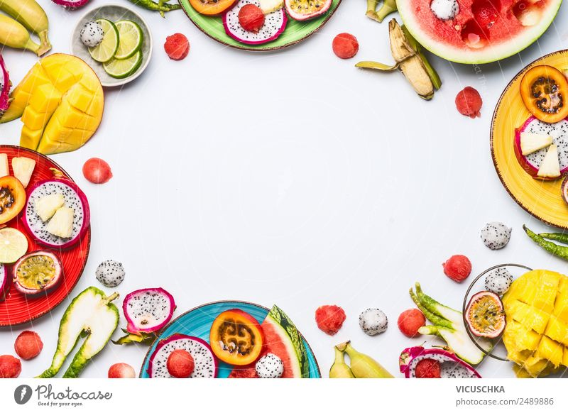 Exotic fruits and fruits cut on plates Food Fruit Apple Orange Nutrition Organic produce Beverage Juice Plate Shopping Style Design Summer Healthy