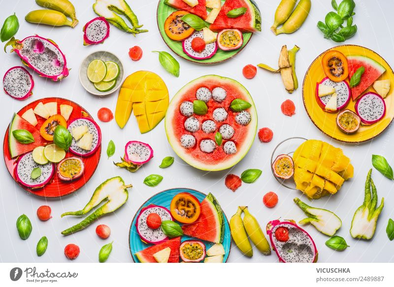 Various tropical fruits and fruits as Bowls Food Lettuce Salad Fruit Orange Nutrition Breakfast Organic produce Vegetarian diet Diet Crockery Plate Lifestyle