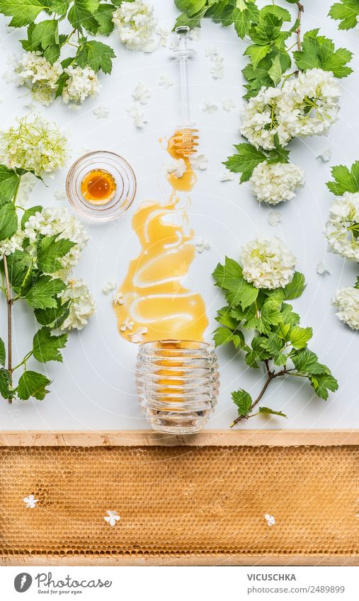 Honey flows from glass and flowers Food Nutrition Organic produce Diet Crockery Style Design Healthy Alternative medicine Healthy Eating Life Summer Table
