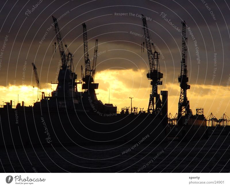 harbor Clouds Crane Ocean Physics Dark Sunrise Sunset Electrical equipment Technology Hamburg Harbour Sky ski Water