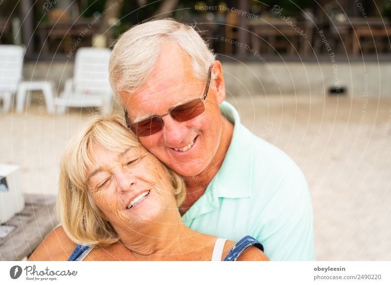 Older couple sit together at the beach. Lifestyle Joy Happy Calm Leisure and hobbies Vacation & Travel Summer Sun Beach Ocean Human being Woman Adults Man