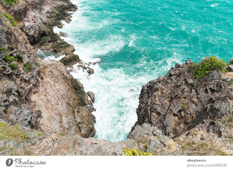 Sea waves breaking against cliff viewed from above. Beautiful Vacation & Travel Ocean Island Wallpaper Landscape Sand Storm Park Rock Coast Aircraft Stone Dark
