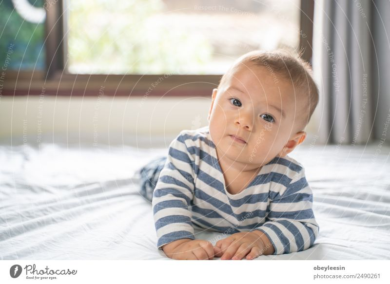 The little boy in the bedroom in bed. Woman Child Human being Blue Beautiful White Face Adults Yellow Funny Laughter Happy Boy (child) Small Dream Infancy