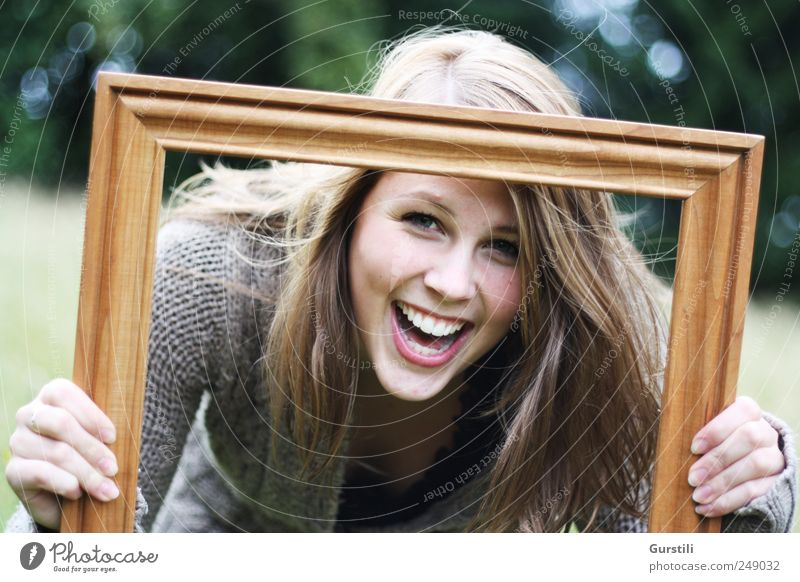 framed. Playing Feminine Young woman Youth (Young adults) Friendship Life Head Face 1 Human being 18 - 30 years Adults Art Picture frame Discover Laughter