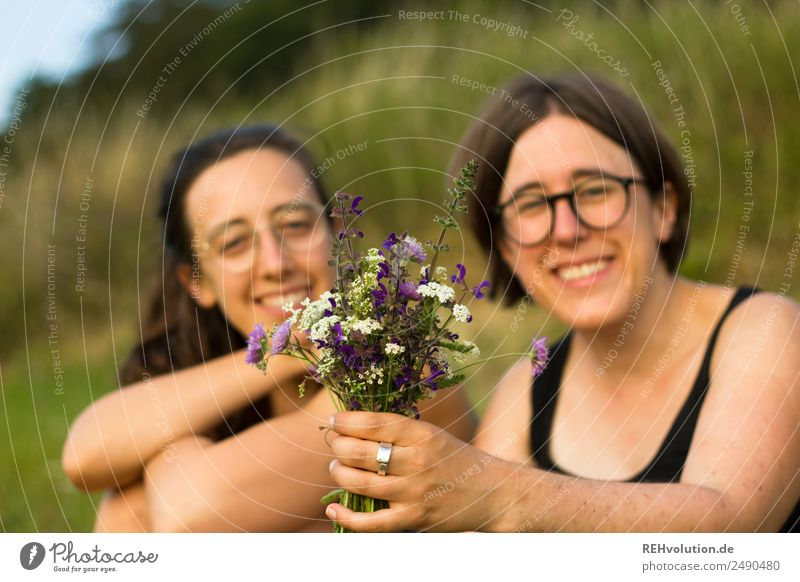 two sisters in the meadow with a bouquet of flowers Lifestyle Healthy Harmonious Well-being Contentment Relaxation Calm Leisure and hobbies Human being Feminine