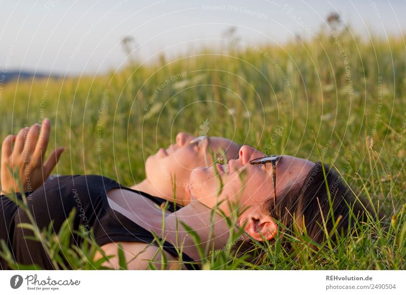 2 young women lying on the meadow Lifestyle Well-being Relaxation Calm Leisure and hobbies Human being Feminine Young woman Youth (Young adults) Woman Adults