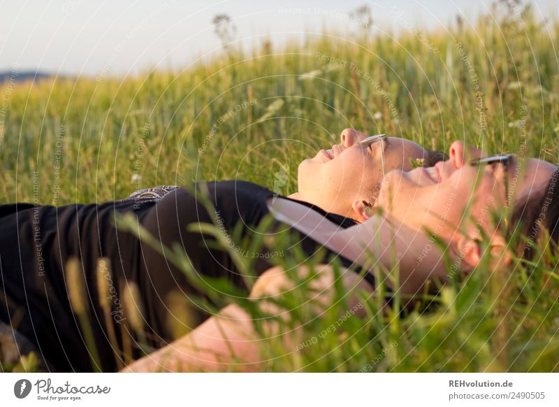 2 women lying on a meadow Happy Free Together Joie de vivre (Vitality) Close-up Smiling To enjoy Meadow Beautiful weather Summer Landscape Sister