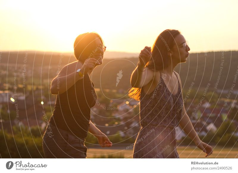 2 young women dancing in the evening sun Lifestyle Joy Happy Harmonious Well-being Leisure and hobbies Vacation & Travel Human being Feminine Young woman