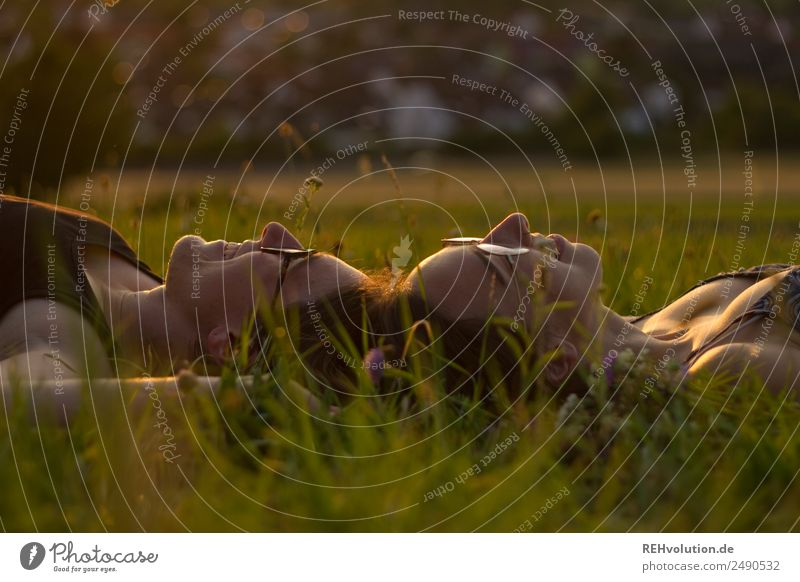 2 young women lying on the meadow Lifestyle Joy Happy Harmonious Well-being Contentment Relaxation Calm Leisure and hobbies Human being Feminine Young woman
