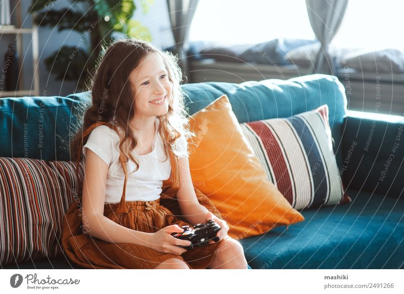 happy child playing video games with gamepad at home Lifestyle Joy Leisure and hobbies Playing Flat (apartment) Entertainment Success Child Schoolchild Computer