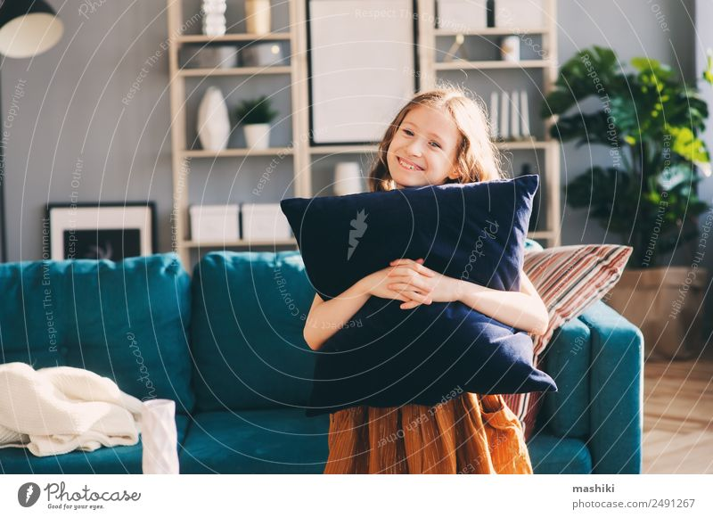 happy cheerful kid girl posing with pillow Lifestyle Happy Flat (apartment) House (Residential Structure) Moving (to change residence) Decoration Living room
