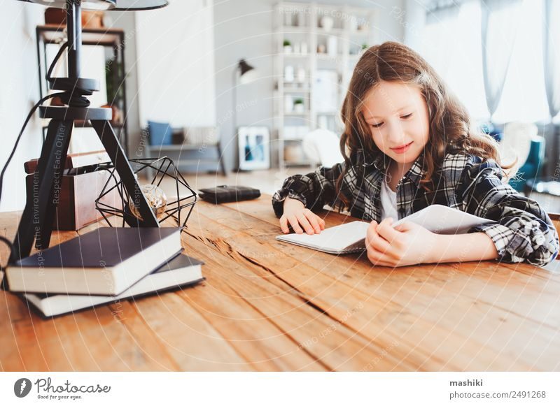 happy school girl doing homework. Smart child working hard Lifestyle Reading Table Success Child School Study Schoolchild Infancy Book Pen Smiling Write