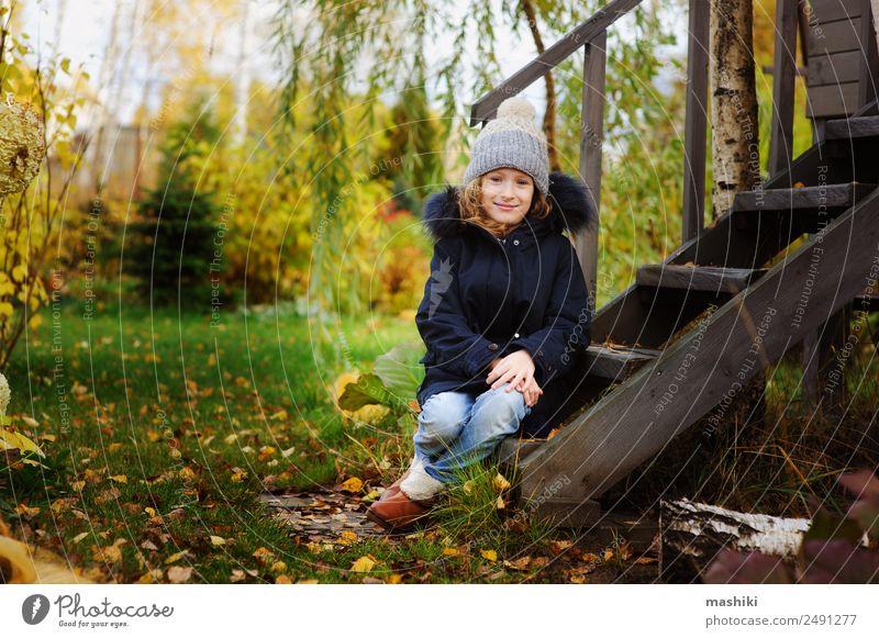 autumn portrait of happy kid girl sitting in garden Child Nature House (Residential Structure) Leaf Lifestyle Warmth Autumn Wood Grass Garden Wild Sit Smiling