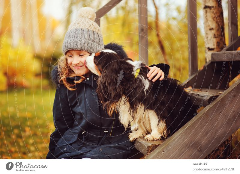 autumn portrait of happy kid girl playing with her spaniel dog Lifestyle House (Residential Structure) Garden Child Friendship Nature Autumn Warmth Grass Leaf